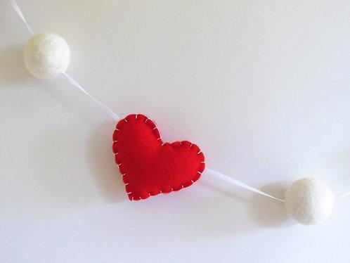Valentine's day felt heart garland with white felt balls in red