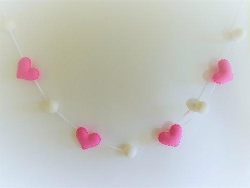 Valentine's day felt heart garland with felt balls in pink