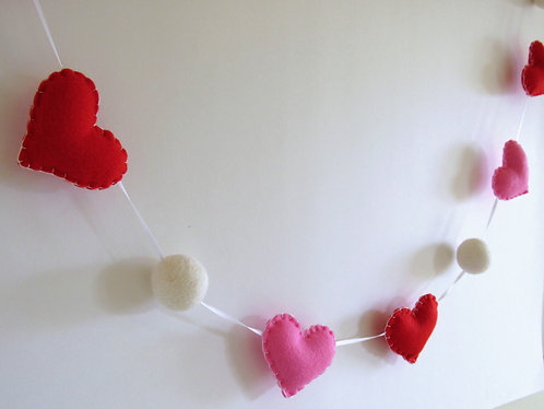 Valentine's day felt heart garland with felt balls in pink and red