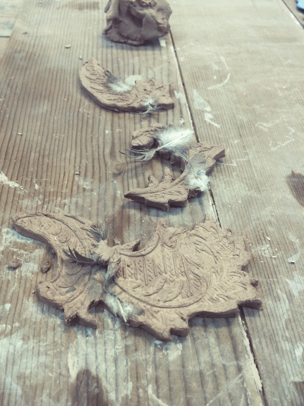 Paper clay and feathers