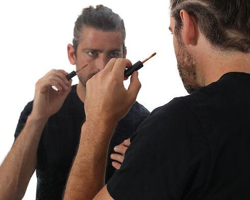 Man appling men's concealer