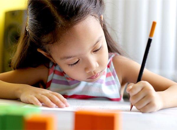 Girl_Writing_boxed_crop.jpg