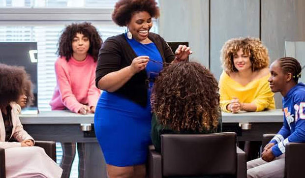 Curly and wavy hair women at a Curl-Ducation Seminar
