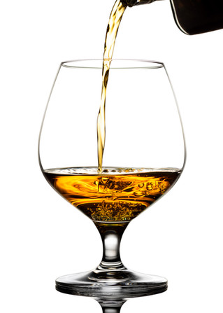 Pouring liquid into snifter glass_web-1.
