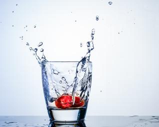 Strawberry splash in glass of water.JPG