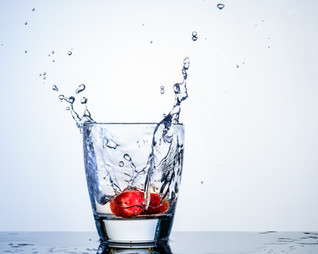 Strawberry splash in glass of water.JPG