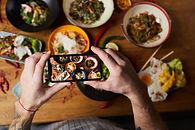 Chef-taking-photo-of-asian-food-547853.jpg