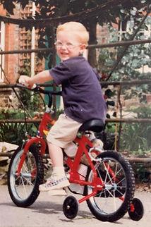 Jack and his new bike.JPG.jpg