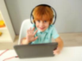 smiling modern preschooler using portabl