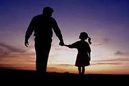 walking in dusk holding hands.jpg