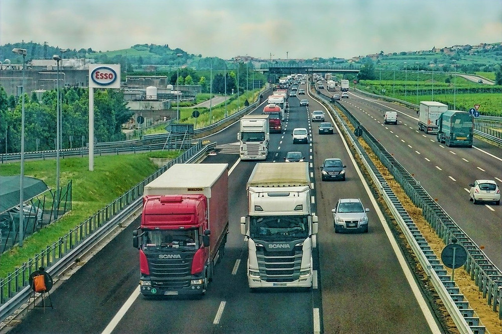 Trucks on the road driving at the optimal speed to help reducing carbon footprint in logistics.
