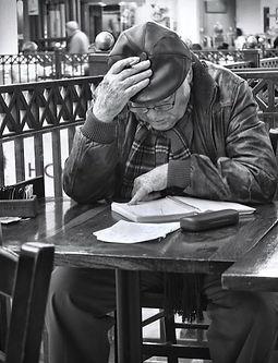 old man reading book.JPG