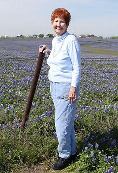 ElizabethHobbs-standing-in-bluebonnets.J