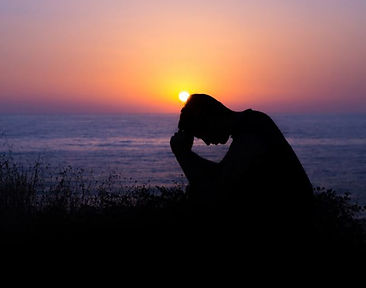Man praying at dusk.JPG