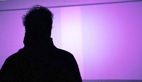 man in purple light.JPG