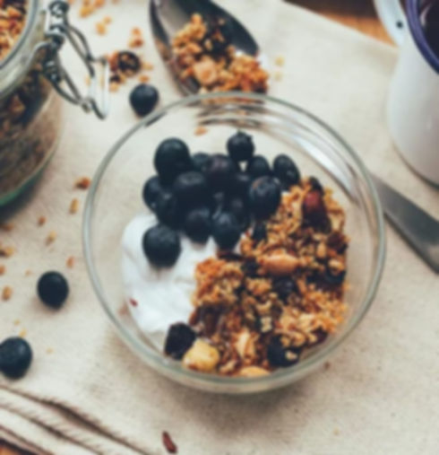 Bowl of cereal, yoghurt, oats, berries and nuts
