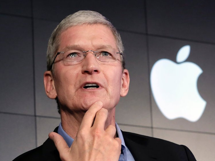 Tim Cook and Apple logo