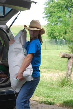 Darcie Unloading Feed Bags