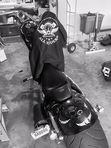 Big Dog Chopper with an All Riders work shirt on it