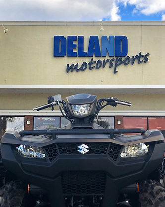 atv in front of dealership