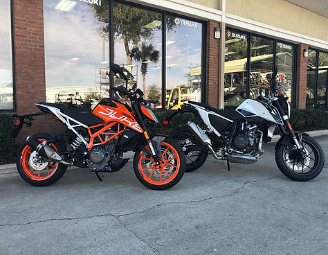 motorcycles in front of dealership