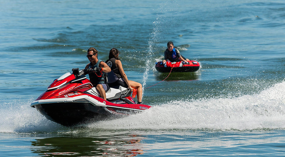 people riding waverunners