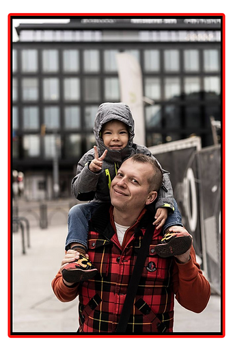 Tomasz and Child.png
