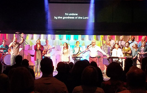 The praise team, band, and choir singing away.