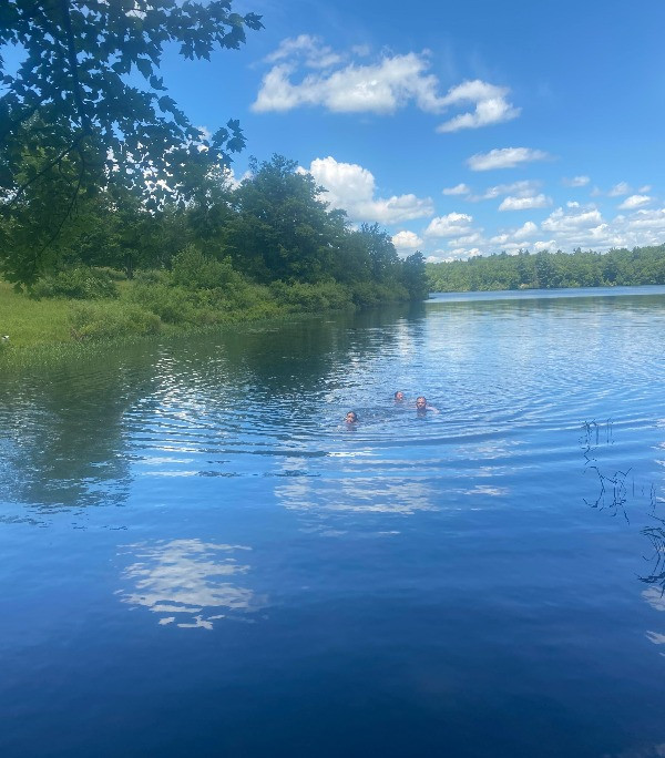 family swimming in the lake
