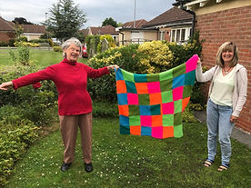 Eleanor and Diane with knitted blanket