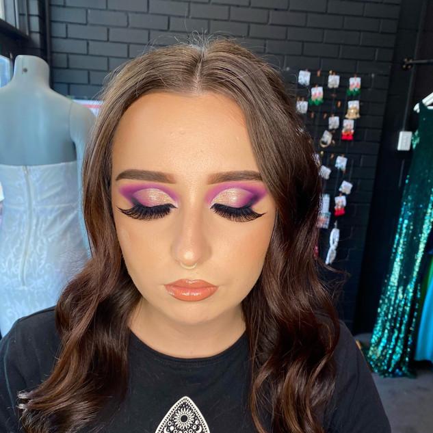 bold purple cut crease glam makeup.jpeg