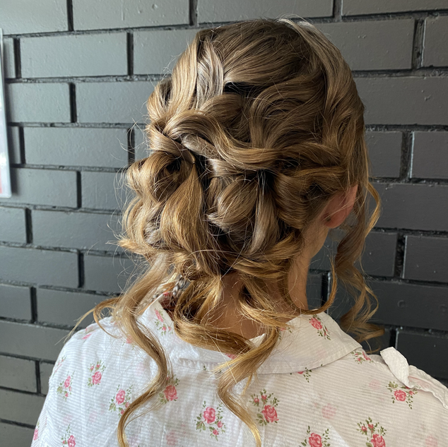 tousseled curly bun formal upstyle hair.