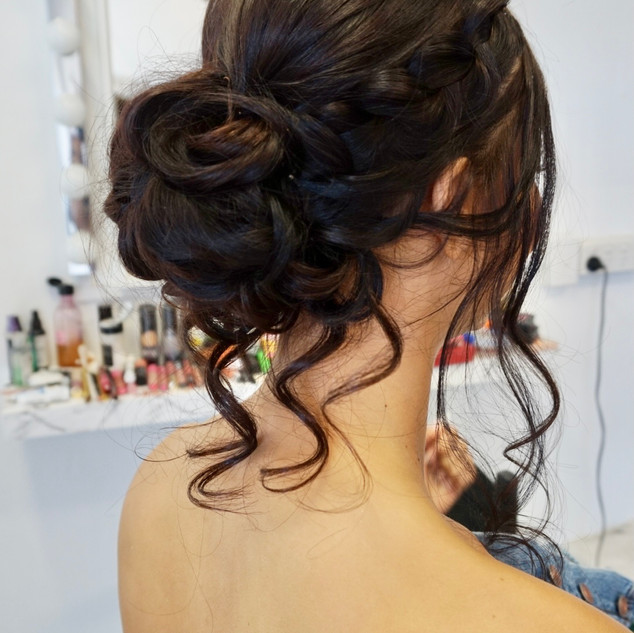 long hair curly bun formal hairstyle wit