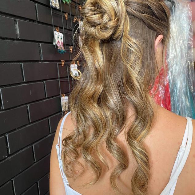 half up half down rose formal hairstyle.