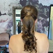 loose curly ponytail formal hairstyle.HE