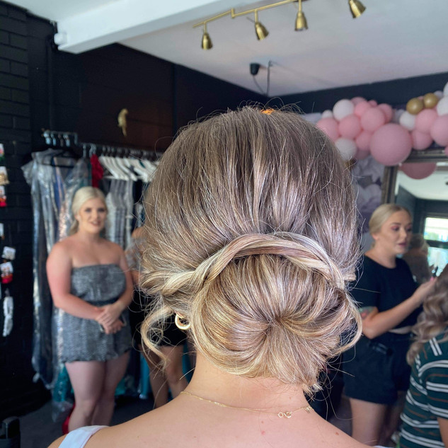 classic bun with twists formal upstyle h