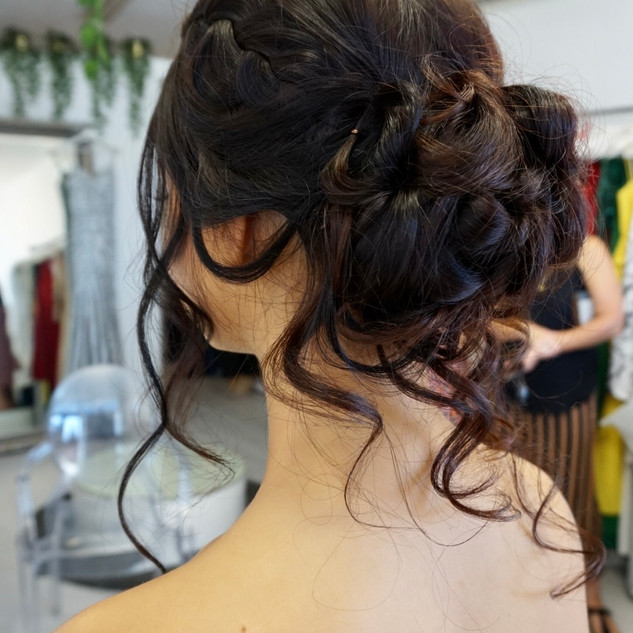 curly bun long hair formal hairstyle wit