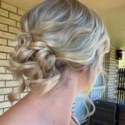 soft curled bun formal hairstyle.jpg