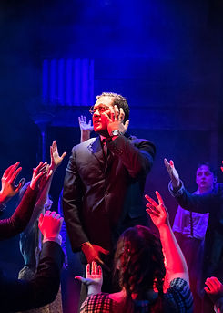 A theatrical picture by Roc Photography of actor Joe Mara in the musical Spring Awakening at BATS Theatre by WITCH Music Theatre. He is performing the song Touch Me and is mid dance.