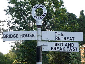 Retreat Cabins Signpost