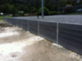 retaining wall plain charcoal sleepers.jpg