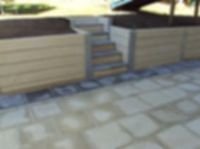retaining wall plain sand colour sleepers.jpg