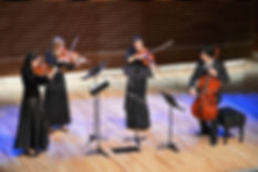 Rachel playing violin in a string quartet at the University of Tennessee School of Music