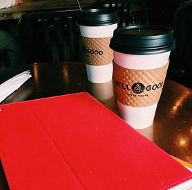 red laptop with coffee cups