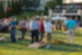 Event reception man playing corn hole
