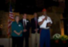 Veteran Participant sharing their story at the Annual TLC Banquet