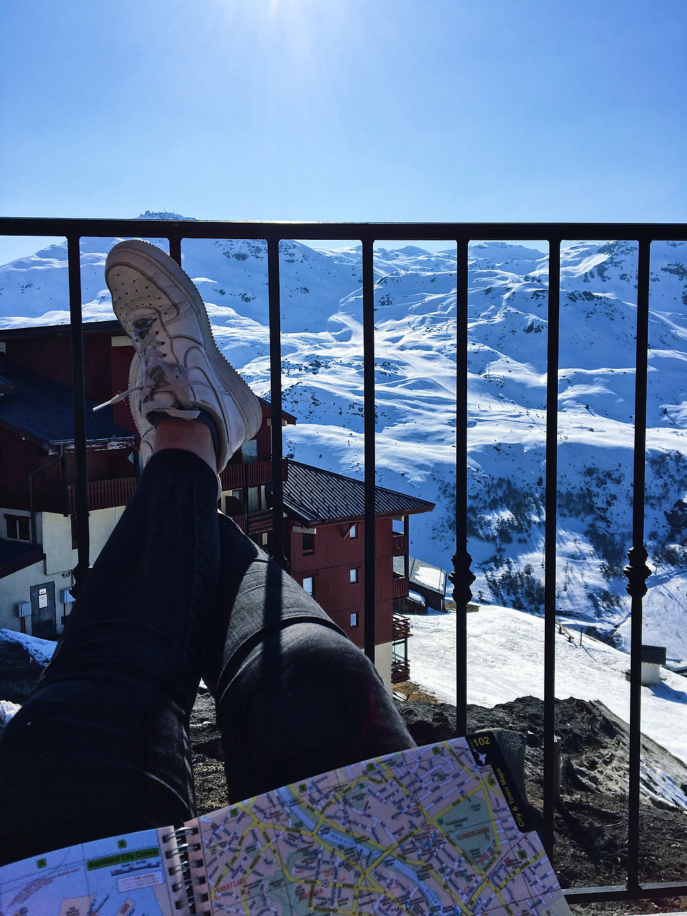 Feet up in the Alps, reviewing my solo travel guides