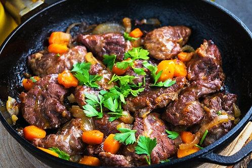 Joue de porc confites aux carottes, polenta gratinée et roquette