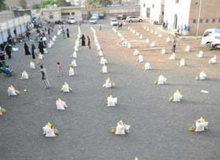 Monareliefye.org delivering needy families 100 Ramadan food baskets in Sana'a