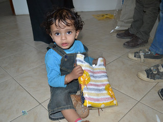 Monareliefye.org delivers kids in Sana'a Eid al-Fitr clothes and toys